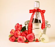 Romantic still life champagne, roses, gifts Stock Photo