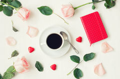 Romantic still life - cup of coffee, peach roses, blank love card and heart shaped candies, love romantic background. Romantic flat lay still life - cup of Stock Images