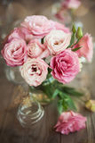 Romantic still life with roses in vase Royalty Free Stock Image