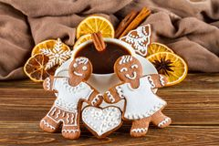 The romantic still life on topic Christmas or New Year - Homemade christmas gingerbreads with a cup of coffee. On wooden boards Royalty Free Stock Photo