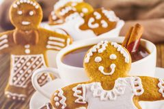 The romantic still life on topic Christmas or New Year - Homemade christmas gingerbreads with a cup of coffee. On wooden boards Royalty Free Stock Images