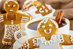 The romantic still life on topic Christmas or New Year - Homemade christmas gingerbreads with a cup of coffee. On wooden boards Royalty Free Stock Photography