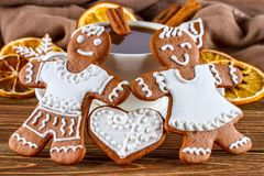The romantic still life on topic Christmas or New Year - Homemade christmas gingerbreads with a cup of coffee. On wooden boards Stock Images