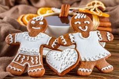 The romantic still life on topic Christmas or New Year - Homemade christmas gingerbreads with a cup of coffee. On wooden boards Royalty Free Stock Image