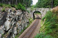 Romantic stone bridge over railway in beautiful forest, Czech republic Royalty Free Stock Photo