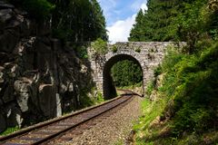 Romantic stone bridge over railway in beautiful forest, Czech republic Royalty Free Stock Photography