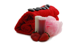 Romantic strawberry flavored Valentine Day SPA set. Including heart shaped towel, soap, sponge, pebbles and strawberries on white background Royalty Free Stock Images