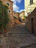 Romantic street in the picturesque small town Fornalutx, Majorca Spain, Mediterranean Sea Island. Royalty Free Stock Images