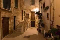 Romantic streets of Polignano a Mare old town by night with poems written on stairs, Apulia region, South of Italy Royalty Free Stock Photography