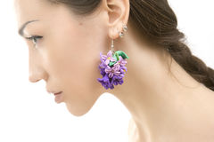 Romantic style: Fashion studio shot of beautiful woman with a fl. Polymer clay jewelery: beautiful woman with a floral earrings, vintage accessories stock images
