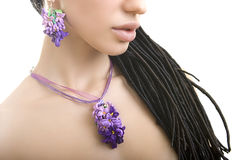 Romantic style: Fashion studio shot of beautiful woman with a fl. Polymer clay jewelery: beautiful woman with a floral lilac necklace around her neck, vintage stock images