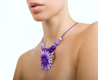 Romantic style: Fashion studio shot of beautiful woman with a fl. Polymer clay jewelery: beautiful woman with a floral necklace around her neck, vintage stock photo