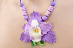 Romantic style: Fashion studio shot of beautiful woman with a fl. Polymer clay jewelery: beautiful woman with a floral orchid necklace around her neck, vintage stock image