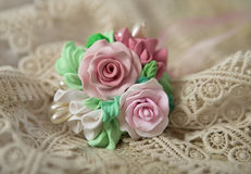 Romantic style: Fashion studio shot of a floral rose necklace (jewelery made of polymer clay) stock photo