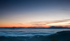 Romantic sunrise in fog valley Royalty Free Stock Photography