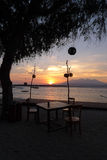Romantic Sunrise at Gili Trawangan. Overlooking the beautiful sunrise at Gili Trawangan and Mount Agung in Lombok, Indonesia from a breakfast table stock image