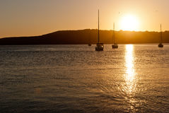 Romantic sunset. On sea with boats in the horizon Royalty Free Stock Photo