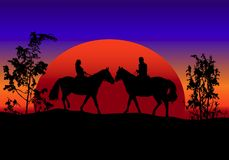 Romantic sunset. Silhouette of two horses and riders at sunset Royalty Free Stock Image