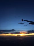 Romantic sunset on the airplane. Open your eyes and see the way our horizon meet Stock Images
