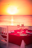Romantic sunset Beach dining Stock Image