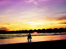 Romantic sunset with a couple Royalty Free Stock Photos
