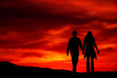 Romantic sunset. Couple walking in a romantic sunset Royalty Free Stock Photo