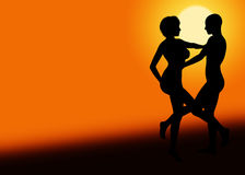 Romantic Sunset Dancing Couple. Romantic silhouette couple dancing against a sunset scene with copy space Stock Images