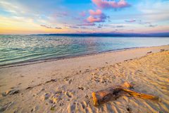 Romantic sunset on desert tropical beach, Indonesia Stock Photos