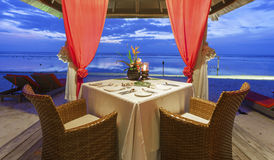 Romantic sunset dinner at the beach Royalty Free Stock Photos