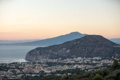 Romantic sunset in the Gulf of Naples and Vesuvius. Sorrento. Italy royalty free stock photo