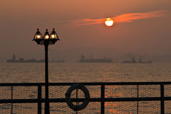 Romantic sunset with lamppost Stock Photos