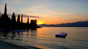 Romantic sunset. Lovely sunset at lake of garda Stock Images