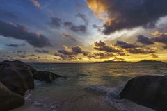 Sunset at paradise beach,anse source d`argent,la digue,seychelle royalty free stock images