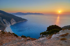 Romantic sunset over Myrtos beach. Romantic sunset over Myrtos beach in Kefalonia island, Greece Royalty Free Stock Photography