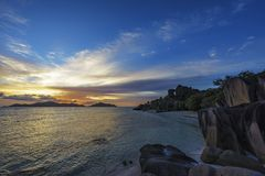 Romantic sunset in paradise, anse source d`argent, la digue, sey Stock Photos