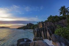 Romantic sunset in paradise, anse source d`argent, la digue, sey Stock Photography
