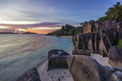 Romantic sunset in paradise, anse source d`argent, la digue, sey Royalty Free Stock Photo