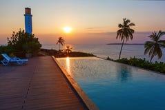Romantic sunset at pool and sea. Sri Lanka Stock Image