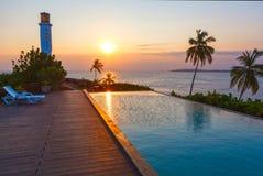 Romantic sunset at pool and sea. Sri Lanka royalty free stock images