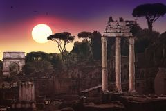 Ruins of the ancient forum in Rome, reminders of a glorious past. A romantic sunset in the ruins of the ancient roman forum in Rome, Italy stock photo