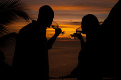 Romantic Sunset in Saint Lucia. A wine sipping couple is silhouetted by the setting sun off the coast of St. Lucia Stock Photography