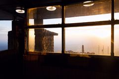 Romantic sunset seen through Jested tower construction, Liberec, Czech Republic. Romantic sunset behind windows of Jested tower construction, Liberec, Czech royalty free stock images
