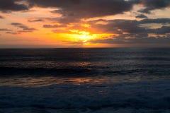 Sunset at sea. Romantic sunset on the serene sea Stock Photos