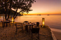 Romantic sunset on the shore of a tropical island. Stock Photos