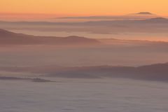 Romantic sunset in the umbria mountains with fog Stock Photography