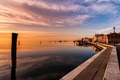Romantic sunset on the Venice lagoon. Island of Pellestrina. Stock Photos