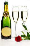 Romantic suprise. Champagne glasses, bottle and red rose isolated on a white background Stock Photo