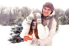 Romantic surprise. Men / boy gifts gift box for women / girl in Stock Photography