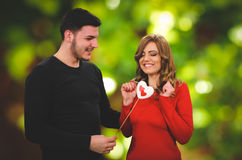 Romantic surprising present for beautifull girl. In red royalty free stock photos