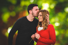 Romantic surprising present for beautifull girl. In red stock image